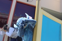 Sophia Rose taking a photo of Stitch.